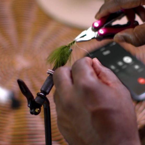 man setting up finishing lures